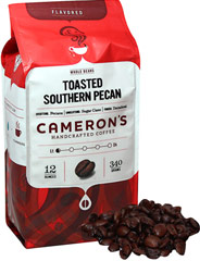 Toasted Southern Pecan Whole Bean Coffee <p><strong>From the Manufacturer's Label: </strong></p><p>Many coffee lovers prefer to grind their coffee beans themselves, because they know that doing so results in an impossibly fresh cup. For anyone who's a fan of the toasty, nutty goodness of pecan pie, Toasted Southern Pecan is the cup of coffee for you. This coffee has a rich, slightly buttery flavor that'll be the highlight of your day. Our Arabica beans are caref